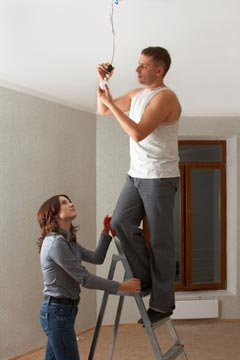 Picture of couple working on wiring