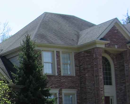 closer view of a house with a hip roof.